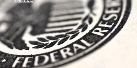 Fed points to early 2015 rate rise with QE end date