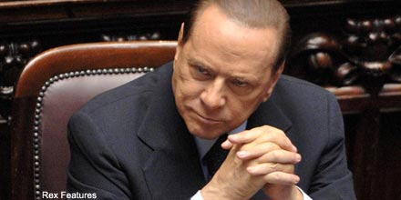 Key coalition partner calls on Berlusconi to step down