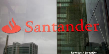 Santander's UK profits pushed into reverse by bank tax