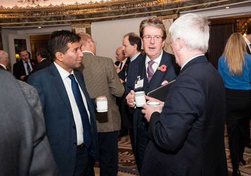 Premier AM's Raj Hallen grabs a coffee at the Wealth Management Forum
