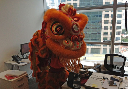The Lion dance brings good fortunes to the Singapore office