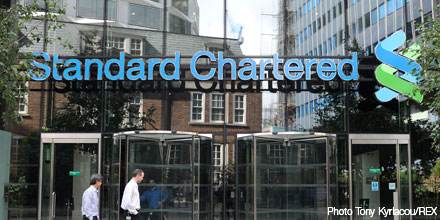 Standard Chartered drives FTSE to record closing high